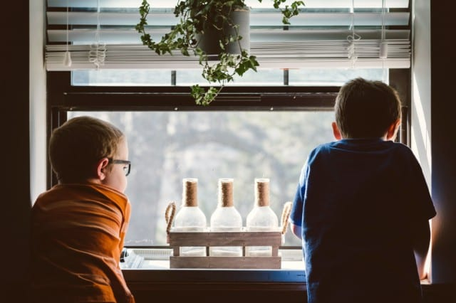 Two children looking out of the window