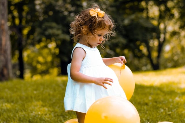 Young girl will balloons
