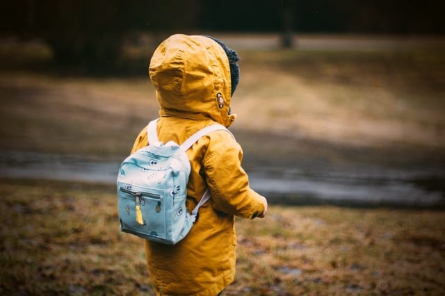 Boy in yellow rain coat