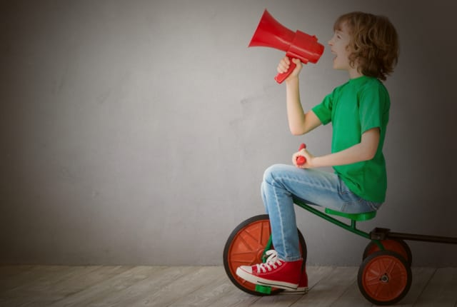 Boy shouting into a megaphone